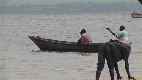 Medium-shot of a man rowing a john-boat amidst a group of... Stock Video Footage