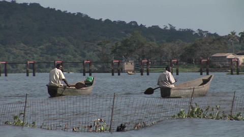 Medium-shot of fishermen rowing their boats on Lake... Stock Video Footage
