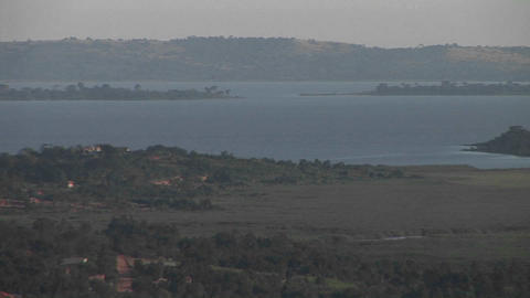 Medium-shot of Lake Victoria in Uganda under a light haze Stock Video Footage