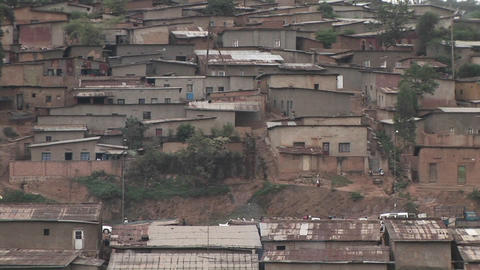 Pan-right slowly across a hillside residential neighborhood in Kigali, Rwanda Footage