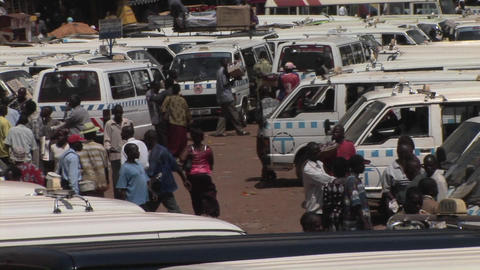 Establishing shot of a crowded bus depot in Kamala, Uganda Stock Video Footage