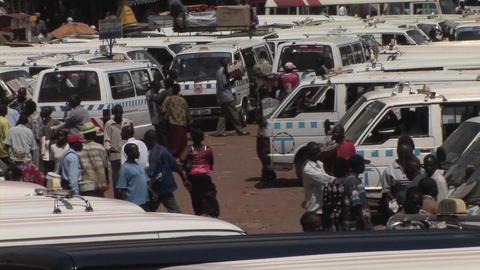 Establishing shot of a crowded bus depot in Kamala, Uganda Stock Video Footage