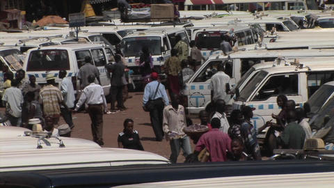 Establishing shot of a crowded bus depot in Kamala, Uganda Footage