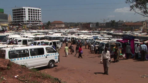 Medium shot time lapse of a busy bus depot in Kampala,... Stock Video Footage