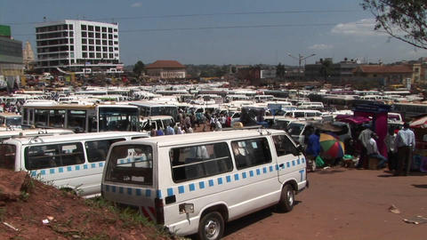 Medium shot time lapse of a busy bus depot in Kampala, Uganda Footage