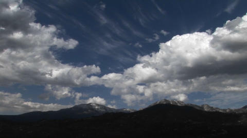 Clouds move above a desert mountain range Stock Video Footage