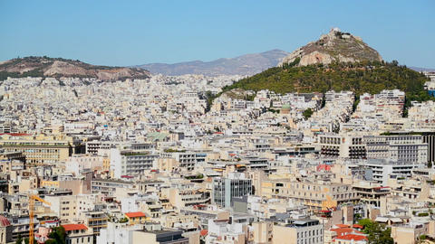 Wide establishing shot of Athens, Greece in bright Footage