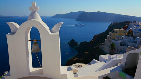 A cruise ship passes a Greek Orthodox church on th Stock Video Footage
