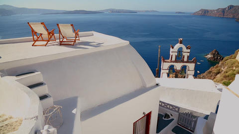 Deck chairs sit on a beautiful balcony in the Gree Stock Video Footage