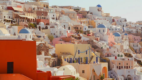 Multi colored houses line the hillsides of the Gre Live Action
