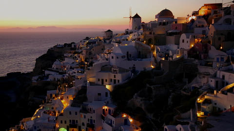 Windmills line the hillsides of the romantic Greek Stock Video Footage
