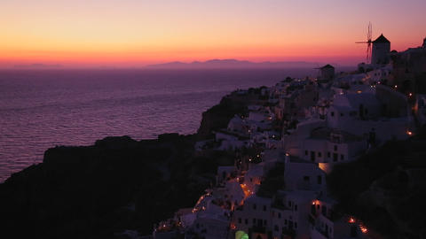 Windmills at dusk or sunset on the romantic Greek Stock Video Footage
