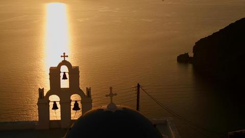 A beautiful sunset behind a Greek Orthodox Church  Footage