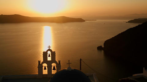 A beautiful sunset behind a Greek Orthodox Church  Footage