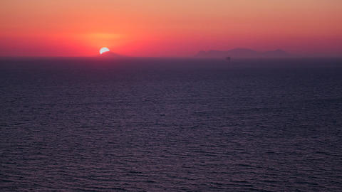 A beautiful sunset behind the ocean in the Greek I Footage