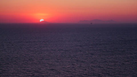 A beautiful sunset behind the ocean in the Greek I Stock Video Footage