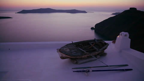 A a rowboat sits on a roof in front of a beautiful Stock Video Footage