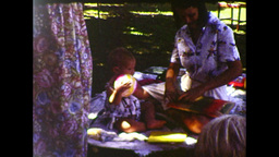 One-year-old Girl Opening Presents At Her 1st Birthday Party (1983 8mm Vintage Home Video) stock footage