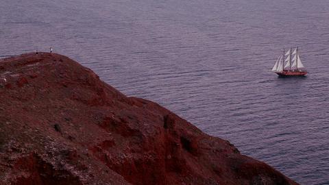 A beautiful sailing ship sails near some islands a Stock Video Footage