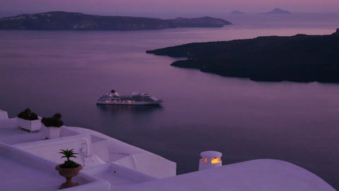 A cruise ship moves through the Greek Isles in pur Footage
