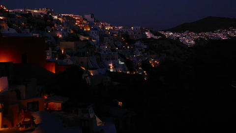 A wide shot of a village on the cliffs of Santorni Stock Video Footage