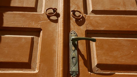 Close detail on a beautiful wooden door in a Greek Stock Video Footage
