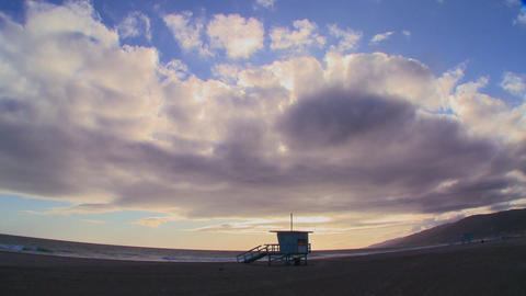 Time lapse of a cloud formations moving behind a l Stock Video Footage