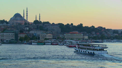 Boats pass in the harbor in front of the mosques o Footage