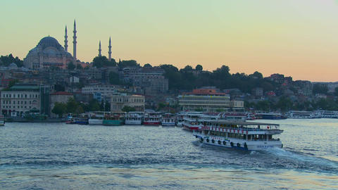 Boats pass in the harbor in front of the mosques o Stock Video Footage