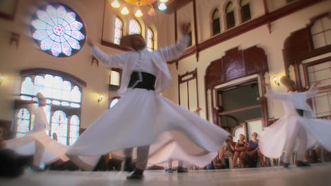 Stylish slow motion shot of whirling dervishes per Stock Video Footage