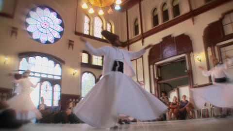 Stylish slow motion shot of whirling dervishes per Footage
