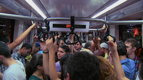 A crowded subway or tram with passengers holding h Stock Video Footage
