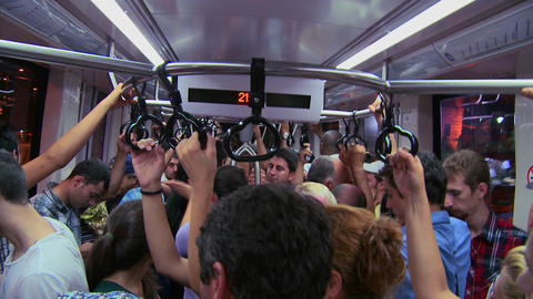 A crowded subway or tram with passengers holding h Footage