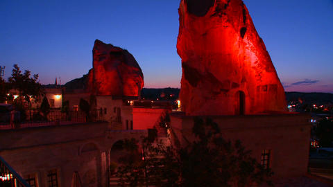 A strange cave hotel glows in the dusk at Cappadoc Footage