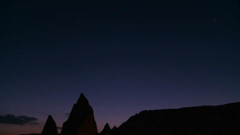 Strange spires are silhouetted at dusk at Cappadoc Stock Video Footage