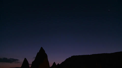 Strange spires are silhouetted at dusk at Cappadoc Footage