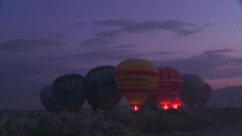 Hot air balloons firing up at dawn Stock Video Footage
