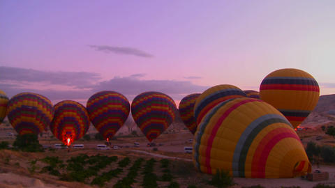 Time lapse shot of hot air balloons firing up at d Stock Video Footage