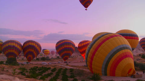 Time lapse shot of hot air balloons firing up at d Footage