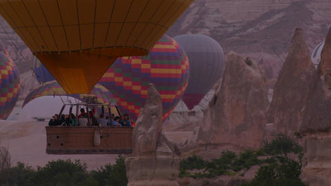 Hot air ballons rise from the desert floor in Capp Stock Video Footage