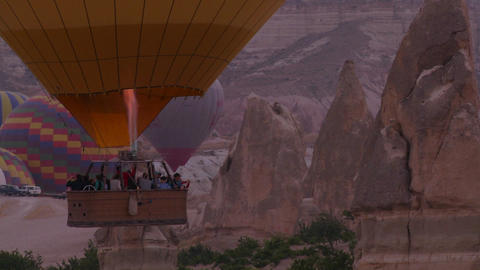 Hot air ballons rise from the desert floor in Capp Footage