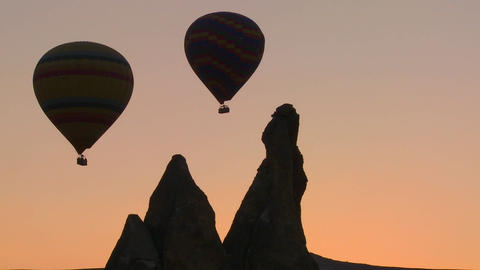 Hot air balloons are beautifully silhouetted again Stock Video Footage