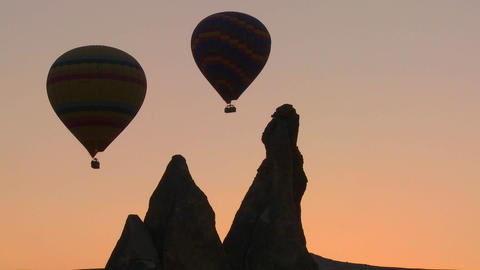 Hot air balloons are beautifully silhouetted again Footage