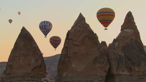 Three hot air balloons are beautifully silhouetted Stock Video Footage
