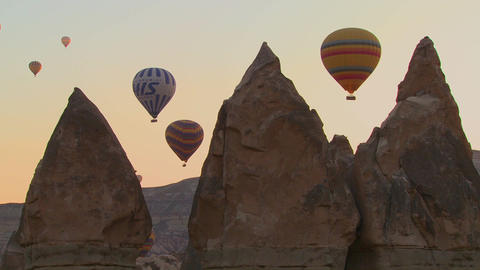 Three hot air balloons are beautifully silhouetted Footage