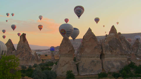 Hundreds of hot air balloons rise in the morning l Stock Video Footage