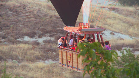 Passengers ride in a hot air balloon that is almos Footage