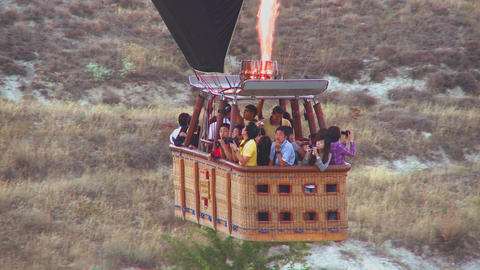 Passengers ride in a hot air balloon that is almos Stock Video Footage
