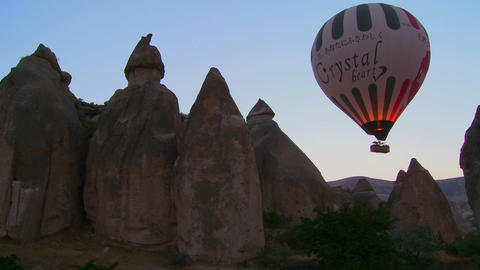 A hot air balloon flies over the magnificent geolo Stock Video Footage