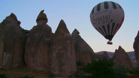 A hot air balloon flies over the magnificent geolo Footage